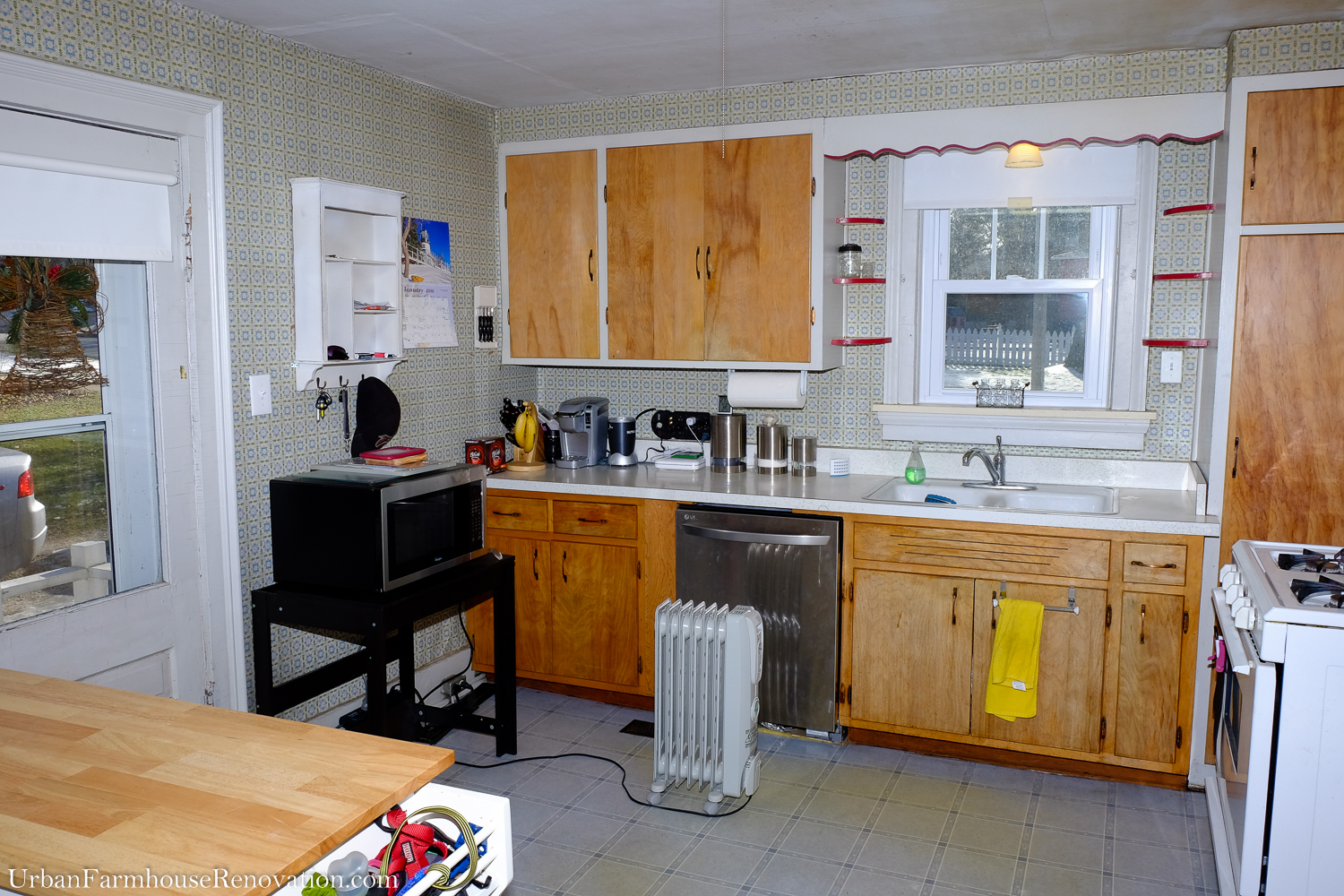 Disfunctional outdated kitchen. Depsite new windows, a portable heater is needed to keep the kitchen warm during winter.